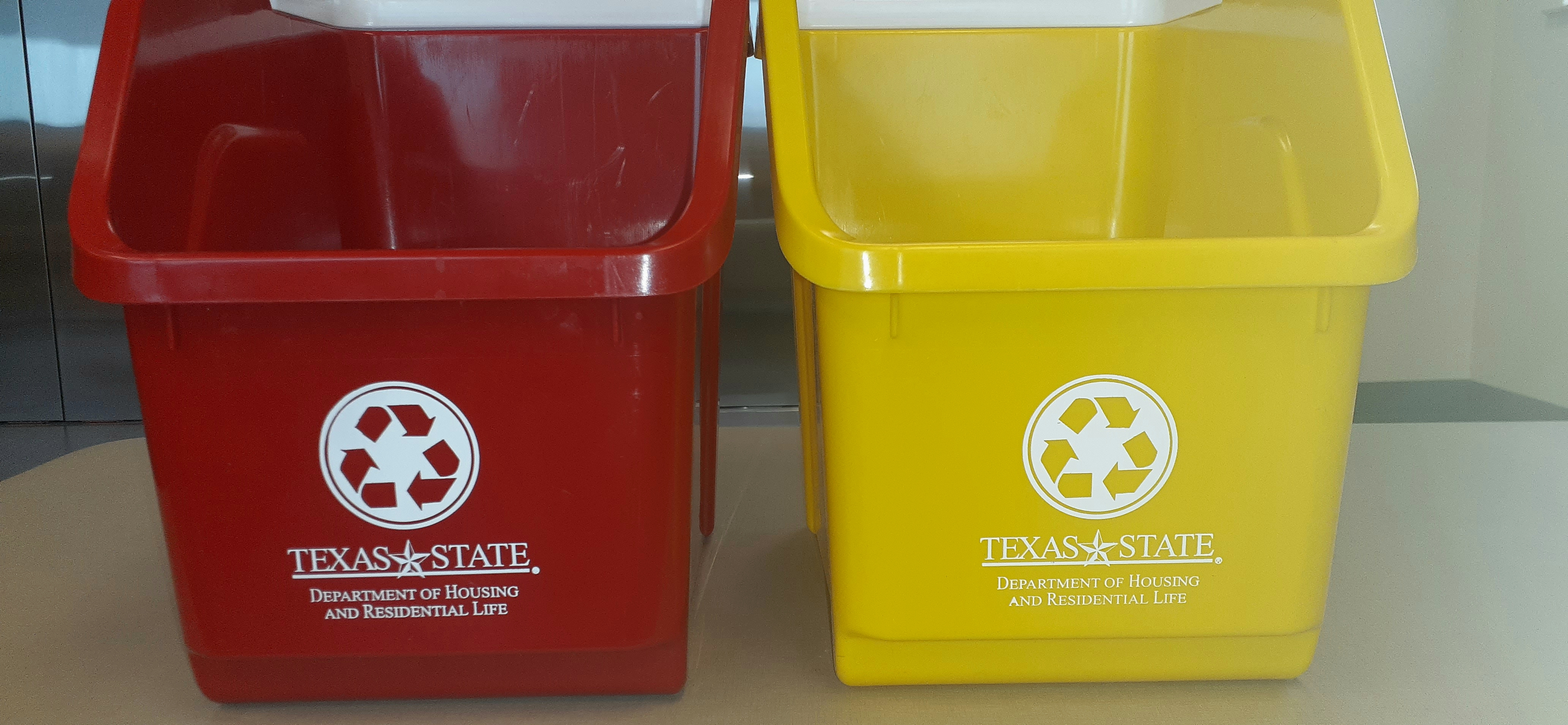 Red and yellow bins sit next to each other with the words Texas State Department of Housing and Residential Life in white letters written in the center of the bin.