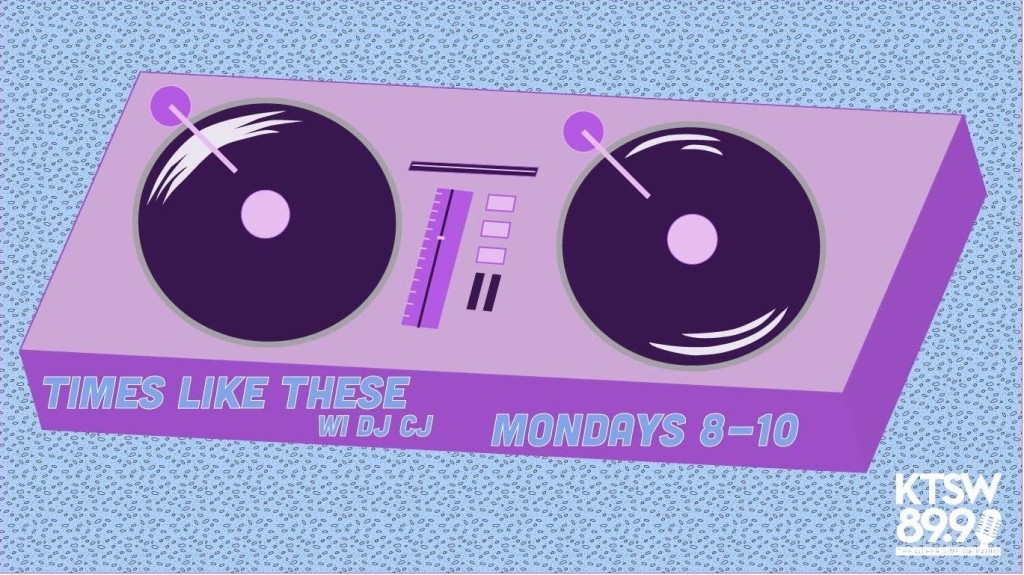 Purple Record spin board with 1 record on either side of it in black. Light Blue background with navy dots. Times like these with DJ CJ Mondays 8-10 on the fron of the record board with KTSW logo in the bottom right.