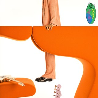 Lacy, in an orange suit, suspends himself from an orange abstract shape. A guitar rests on another shape and the head of another guitar peeks from the bottom of the frame. All is set in front of a white background.