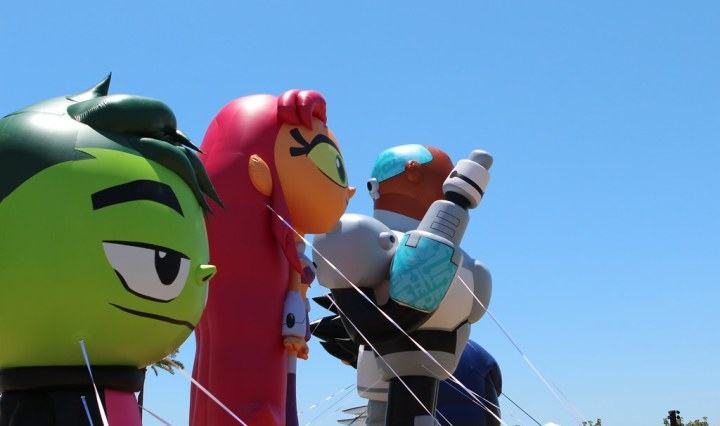 "Three large balloons depicting the characters of Beast Boy, Starfire and Cyborg from ""Teen Titans Go!"""