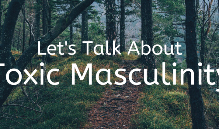 A path in a forest with white lettering that says let's talk about toxic masculinity