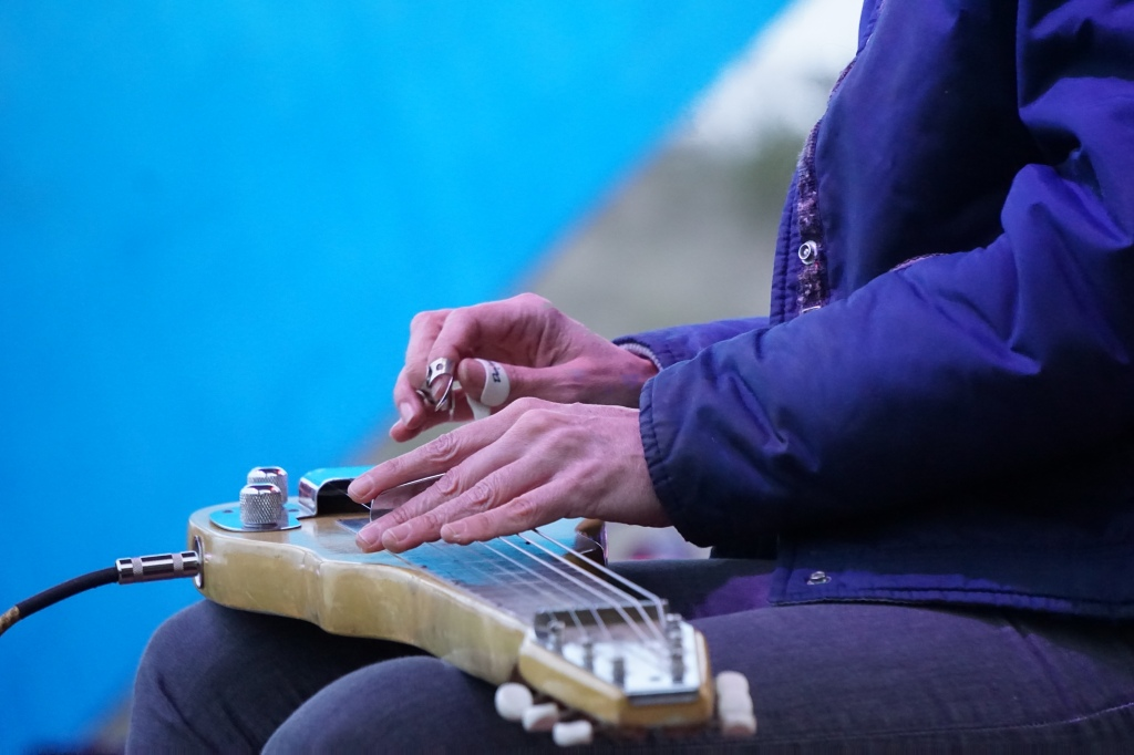 Sharp focus on hands and an electric lap guitar during Erika Wennerstrom's set