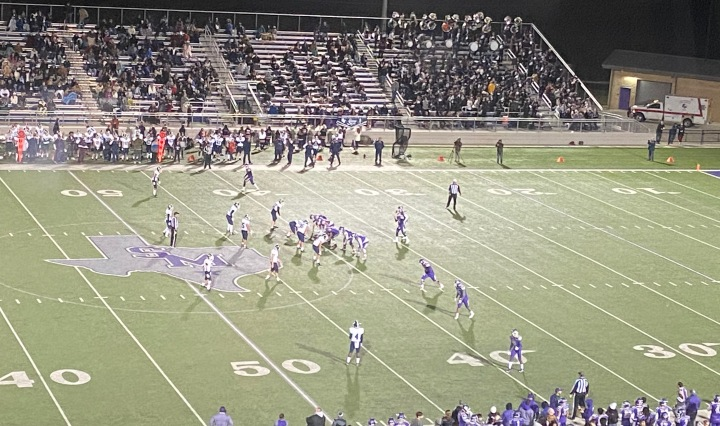 San Marcos is on offense running a play against the Smithson Valley defense
