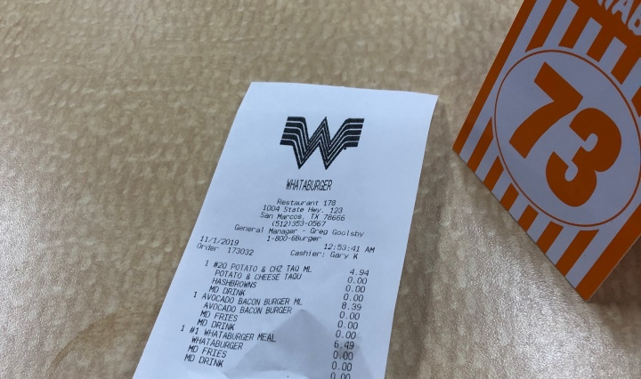 This is a picture of a whataburger number and the receipt on what my friends and I bought.