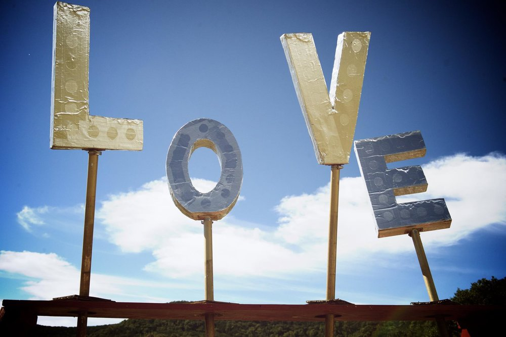 "Big letters facing towards the sky that spell out ""LOVE"""