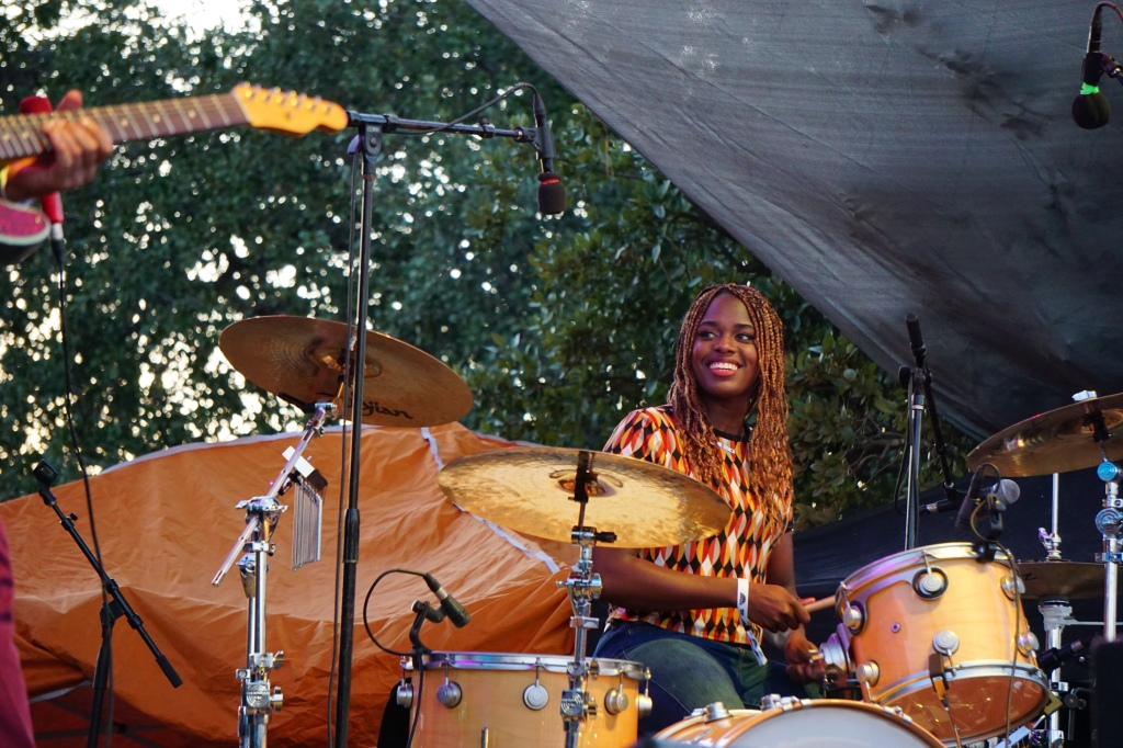 "Tikyra Jackson smiling big while drumming to the song ""What Did I Do?"""