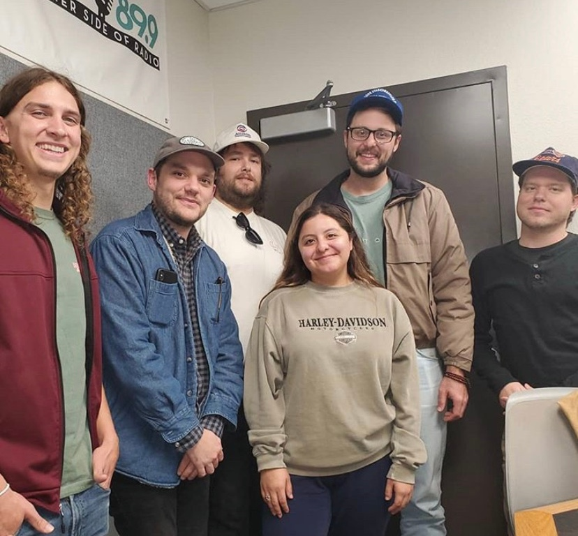 Mason Moore and Elise Montemayor photographed with Tyler, Robert, jake and Phil of Tyler Jordan and The Negative Space.