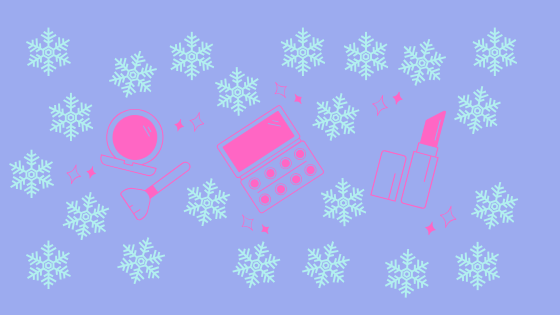 Pink cosmetic products with blue snowflakes as background.