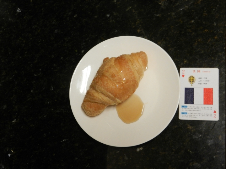 Homemade French croissant meal covered with syrup