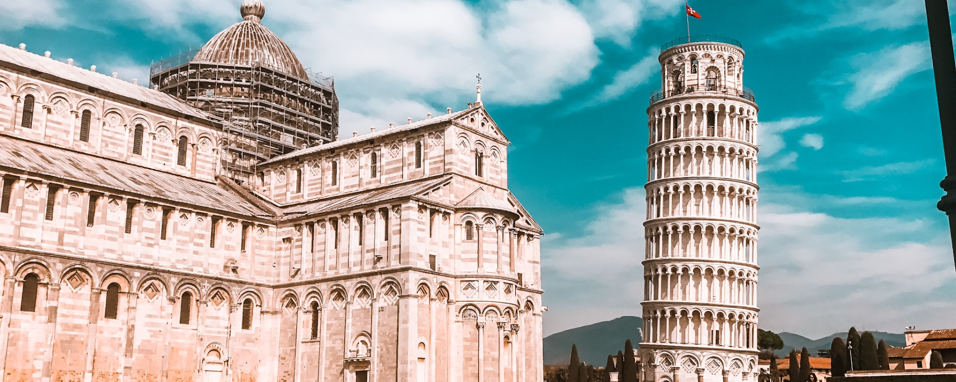 The Leaning Tower of Pisa and the Cathedral of Pisa gather large crowds around it