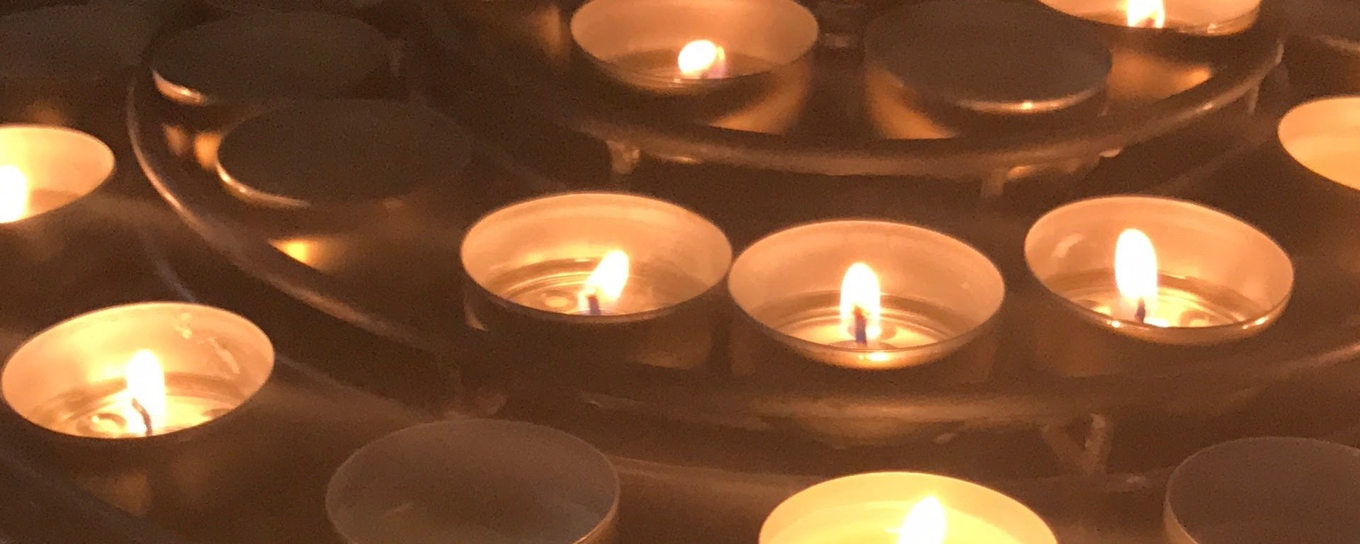 small candles stacked on a rack