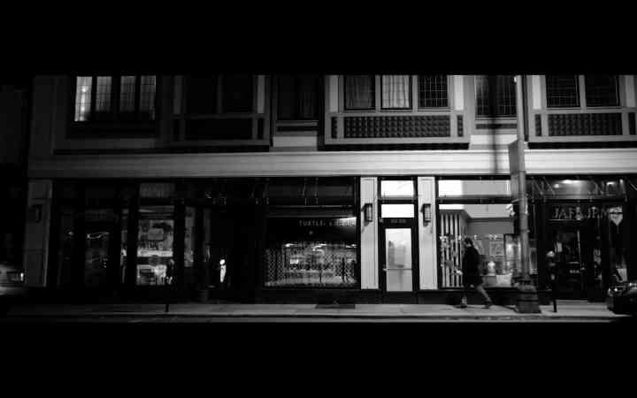 screenshot from Empathy, Inc of Joel walking down a street