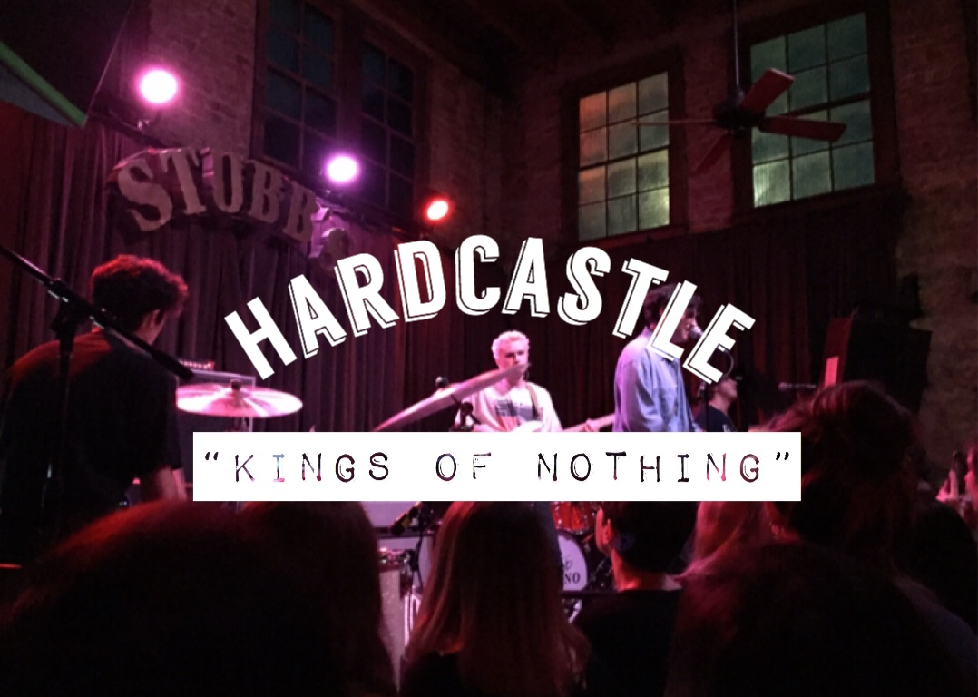 ": In the background, you can see the four boys on stage. The Stubbs logo behind them as they play beneath the stage lights. In the foreground, there is a white title. The band's name Hardcastle is curved downward, and beneath it the words ""Kings of Nothing."""