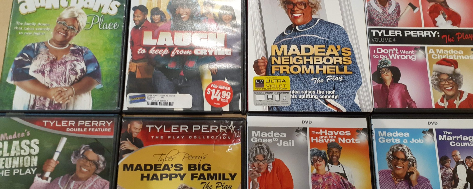 Eight of Tyler Perry's play DVD's side by side