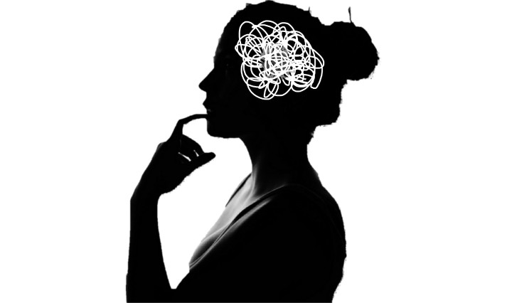 Profile silhouette of a woman with scribbles in her head