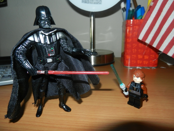 An action figure of Vader standing with a Lego mini-figure of Anakin.