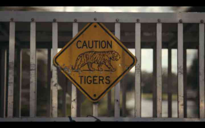 screenshot from Tiger King of a caution sign