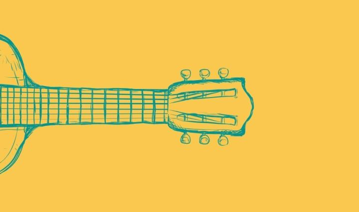 The picture is a transparent acoustic guitar against a yellow background.