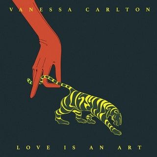A black album cover with a simple drawing of a red hand holding a tiger's tail. At the top of the image is the artist's name and at the bottom is the name of the album.