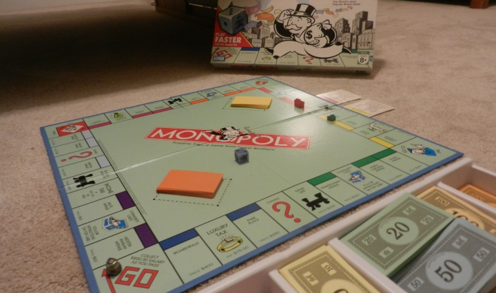 A game of Monopoly set up with a speed dice.