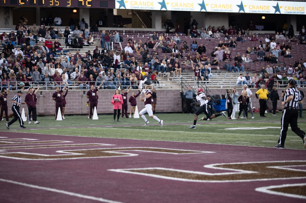 Senior Hutch White makes the catch with the football in his face around the 7-yard line. Fans are in the background amazed by the catch.