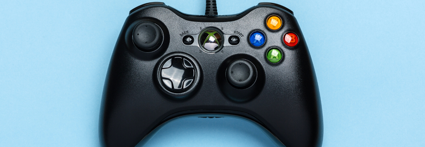 A black Xbox controller on a blue background