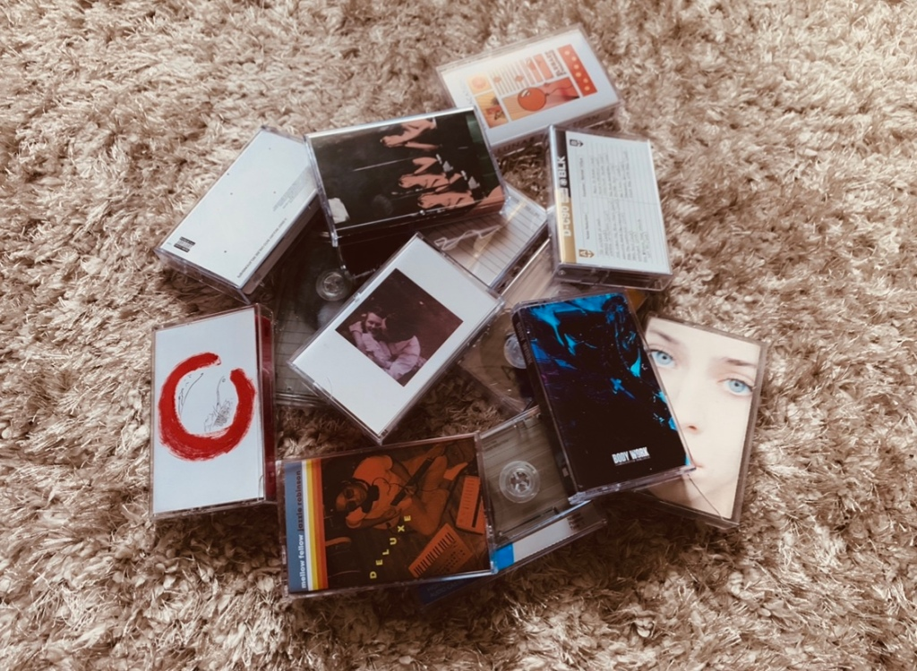 The photo shows a collection of different cassette tapes