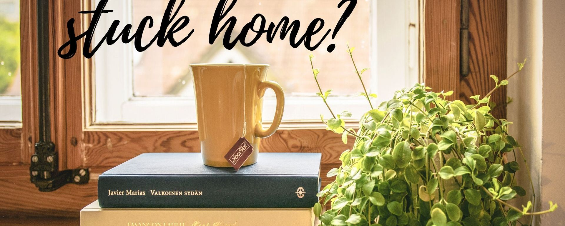 "Picture of books, tea, and the words ""stuck home?' across it"