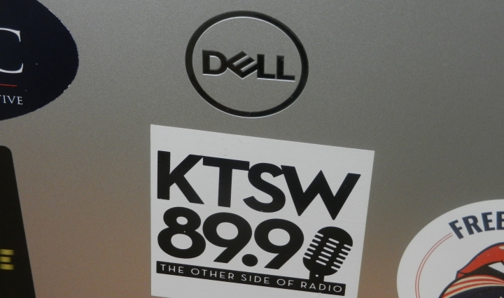 A KTSW sticker displays proudly on a laptop.
