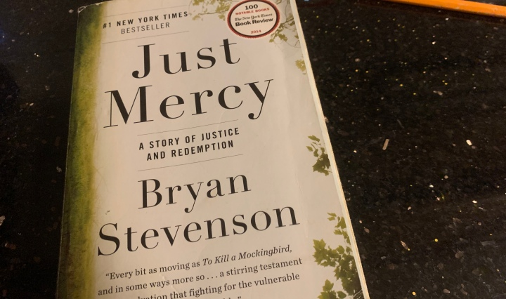 book cover for Just Mercy on black countertop