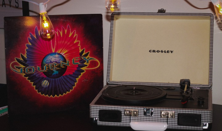 A Journey album alongside a record player.