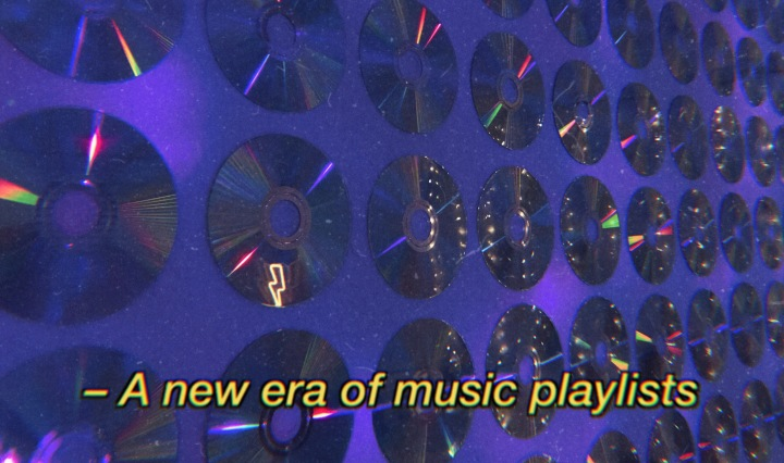 "A wall with horizontal rows of CDs with yellow text that reads ""a new era of music playlists"""