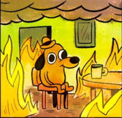A dog with a hat sits at a table in an apartment that is engulfed in flames. Despite the chaos, the dog has a smile on his face and is sitting calmly.