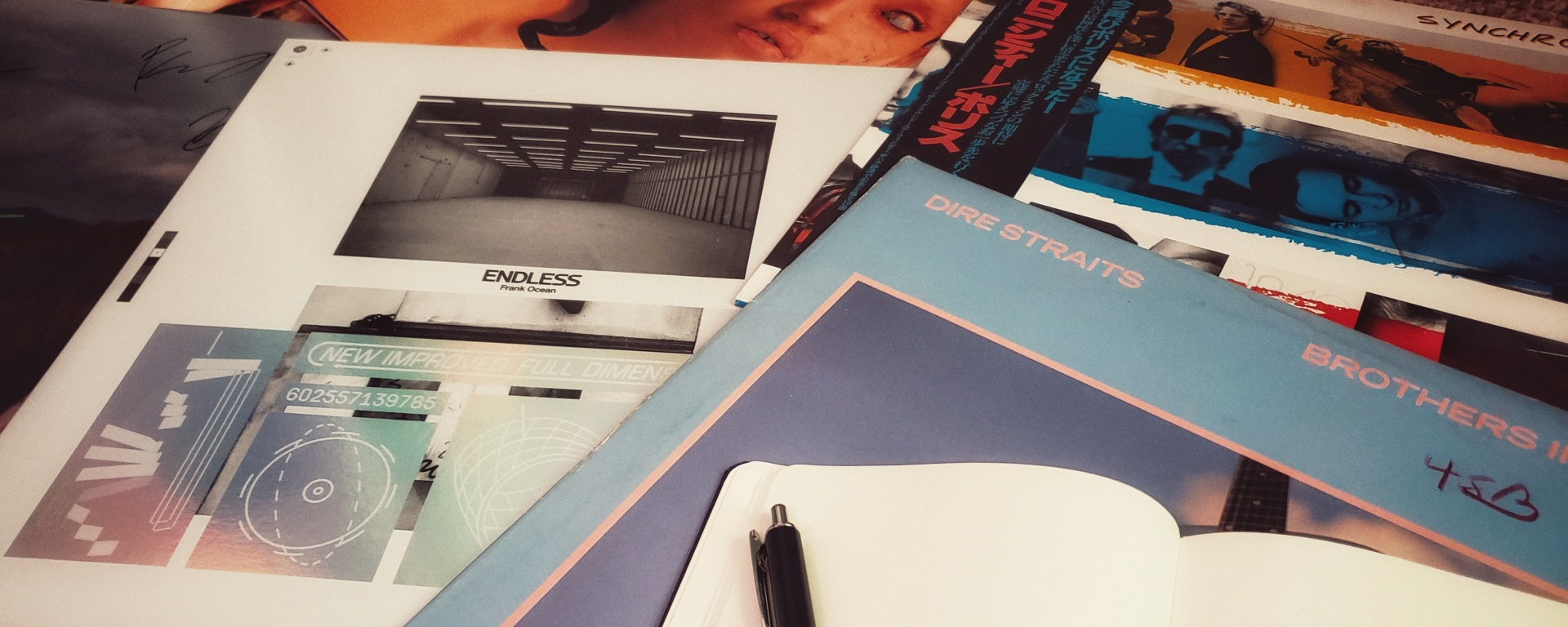 Various vinyl records with notepad