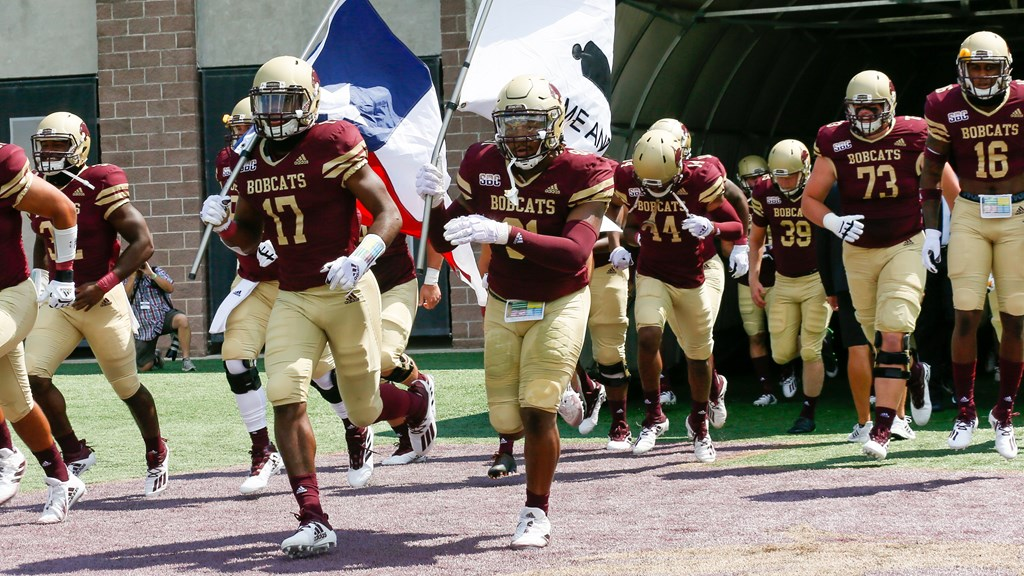 Texas State Bobcats run onto Jim Wacker Field prior to kickoff of a 2020 season home game.