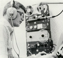 black and white photo of a man using radio technology