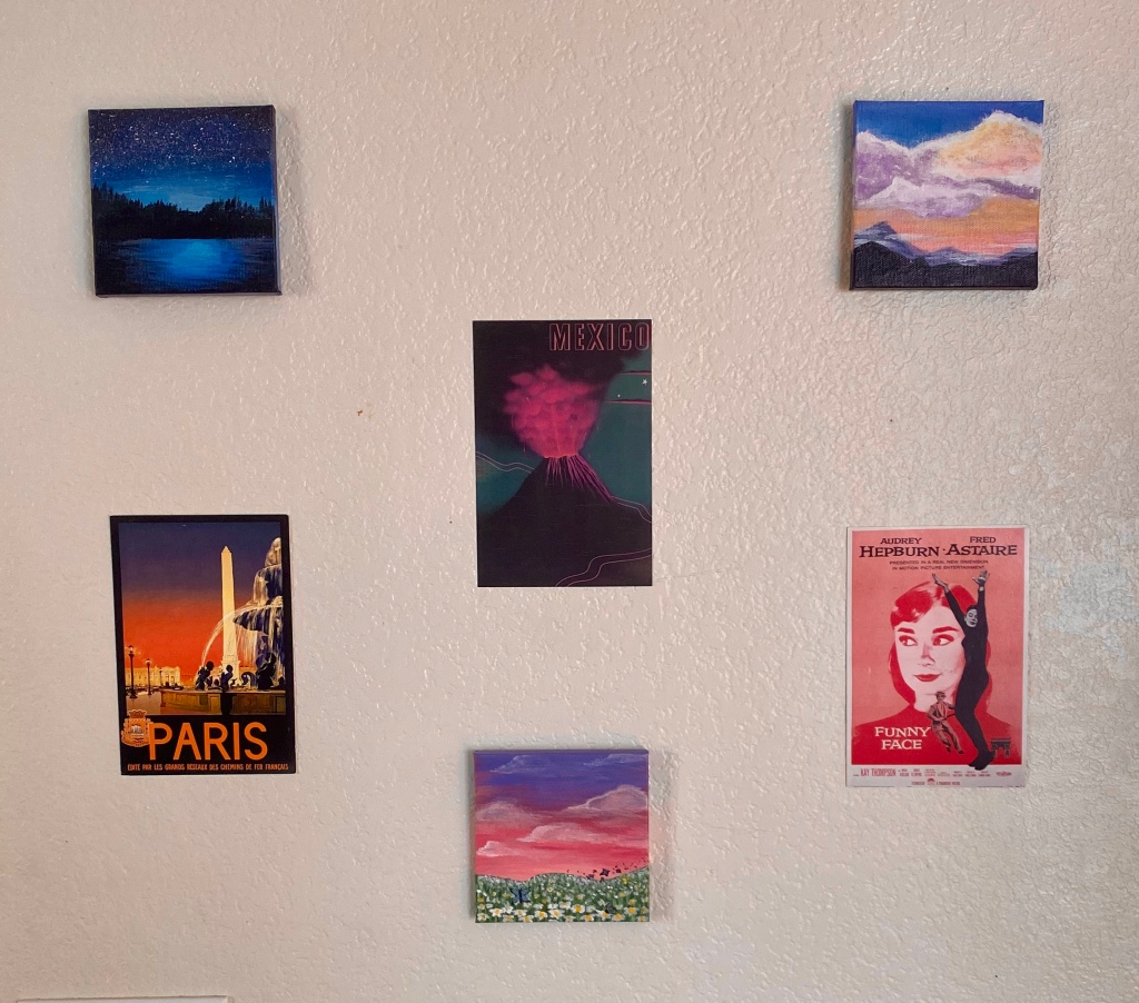 Images hanging on a white wall