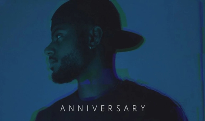 "Blue background with Bryson Tiller and the words ""Anniversary"" on the bottom."