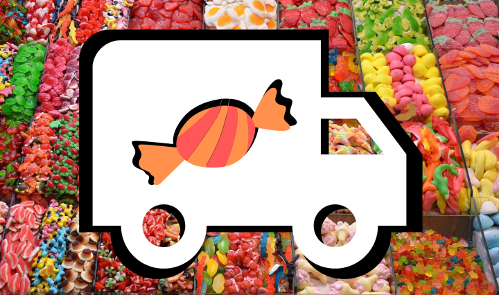 Graphic truck with candy in the background.