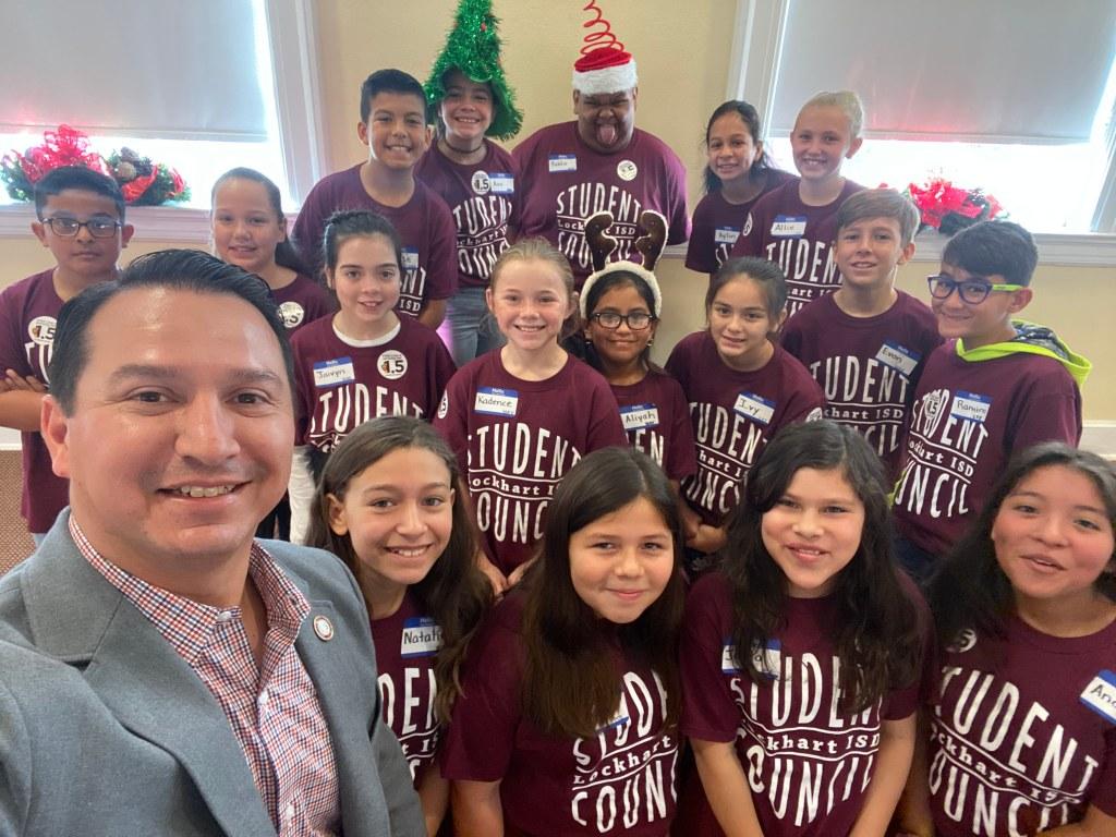 Estrada with students