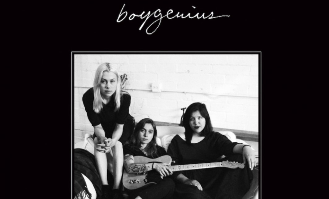 black background with black and white image of the 3 singers in the band boygenius