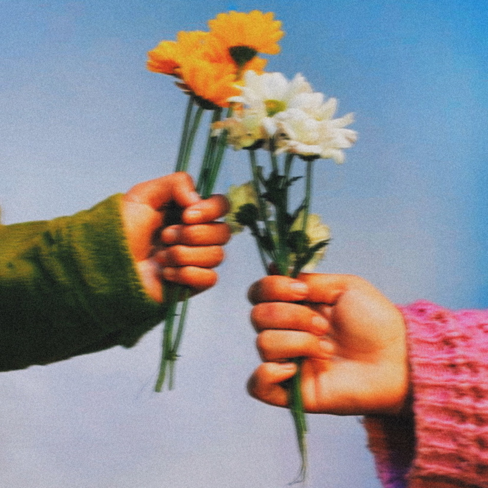 """Dream of Eros"" EP cover art by Martin Delgado, an image of two hands holding flowers."