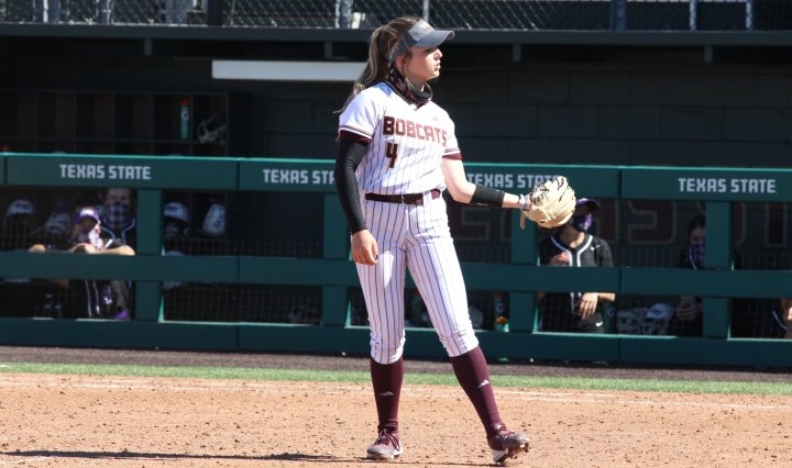 Texas State Softball pitcher Jessica Mullins receives the ball back from the catcher after making a pitch.