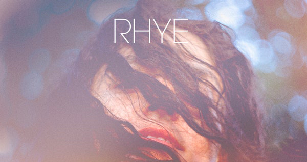 Home's cover features a translucent image of a topless woman layered on top of rolling mountains at sunset.