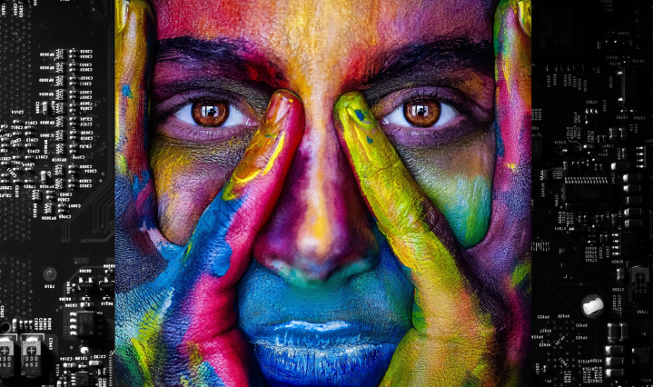 Image of a person painted in multiple colors with a software-themed background.