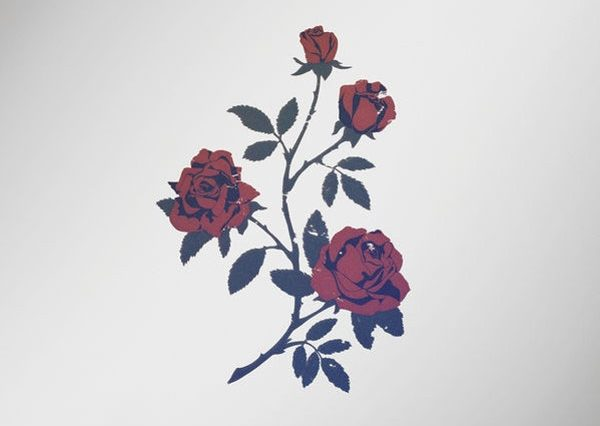 The album cover is a graphic of roses on a gray background