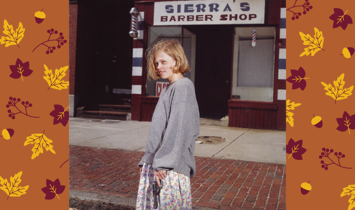 Image of the art cover for Drop Nineteens' album Delaware, a photo of a young women with short blonde hair looking at the camera in front of a barbershop, holding a gun
