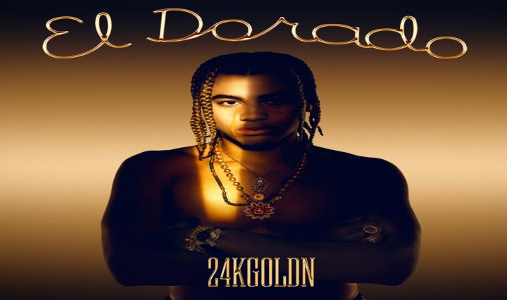 "The album cover for El Dorado by 24kGoldn shows 24kGoldn standing with his arms crossed in gold and black light with ""El Dorado"" written in cursive above him"