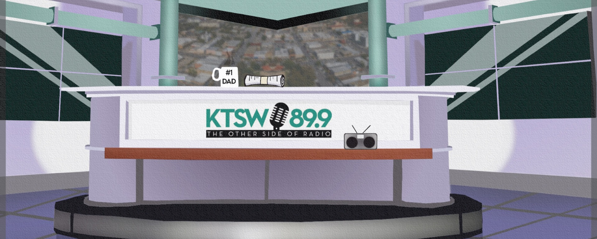 news room graphic with ktsw 89.9 logo. Coffee cup on news desk and news paper roll.