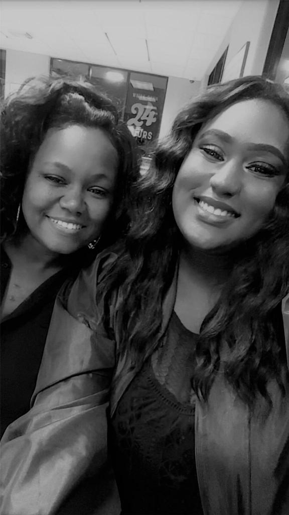 A black and gray photo of a mother and daughter.